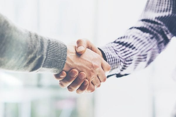 two caucasian males shaking hands - Real Projectives | Maryland Private Equity, Advisory and Real Estate Project Management