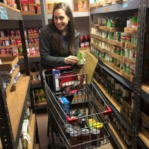 woman with shopping cart with food donations - Real Projectives | Maryland Private Equity, Advisory and Real Estate Project Management